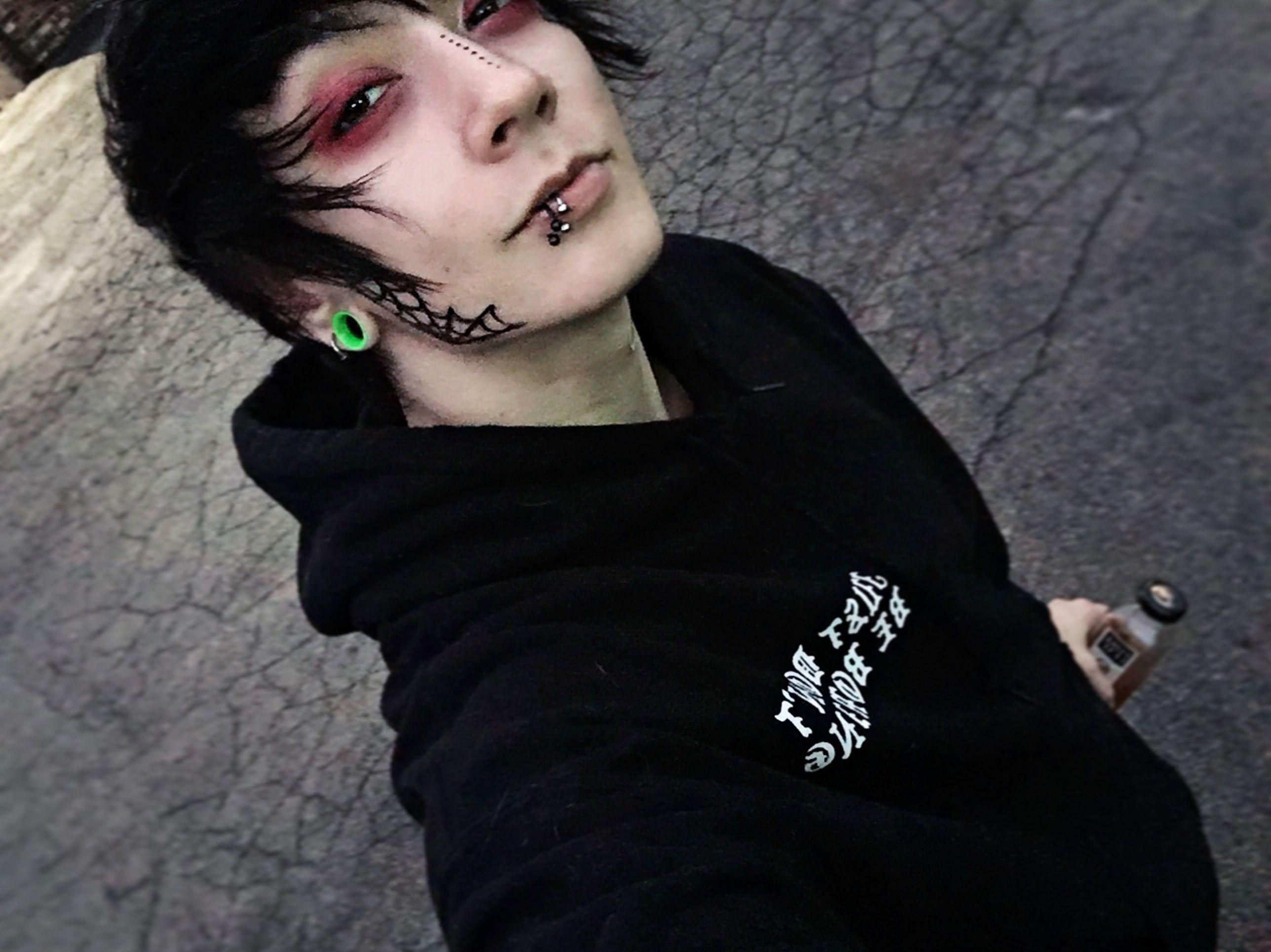 Red eyeshadow black clothes spiderweb tattoo on my jawline my