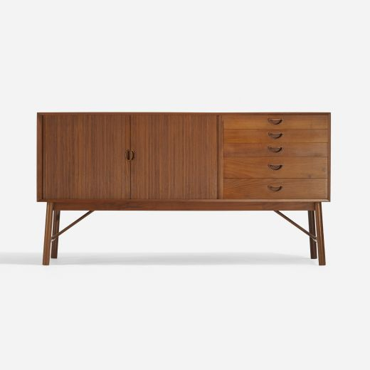 Peter Hvidt and Orla Mølgaard-Nielsen cabinet, model 26025, Søborg Møbelfabrik, Denmark, 1965. Teak, 65.25 w x 19 d x 34 h inches. Cabinet features five drawers and two tambour doors concealing one adjustable shelf. | Wright Now