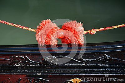 An  detail of the traditional gondola in pink colors, in Venice, Italy, Europe.