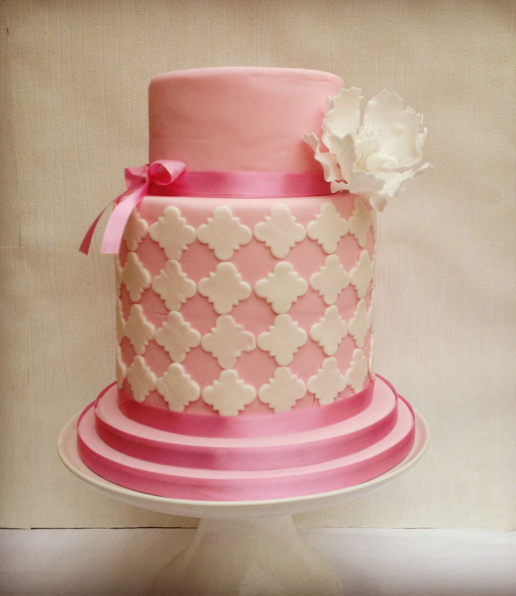 A double barrel girls cake with sugar peony for a birthday ...
