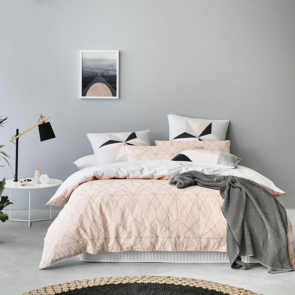 a chic modern bedroom with a white, gray, and blush pink color
