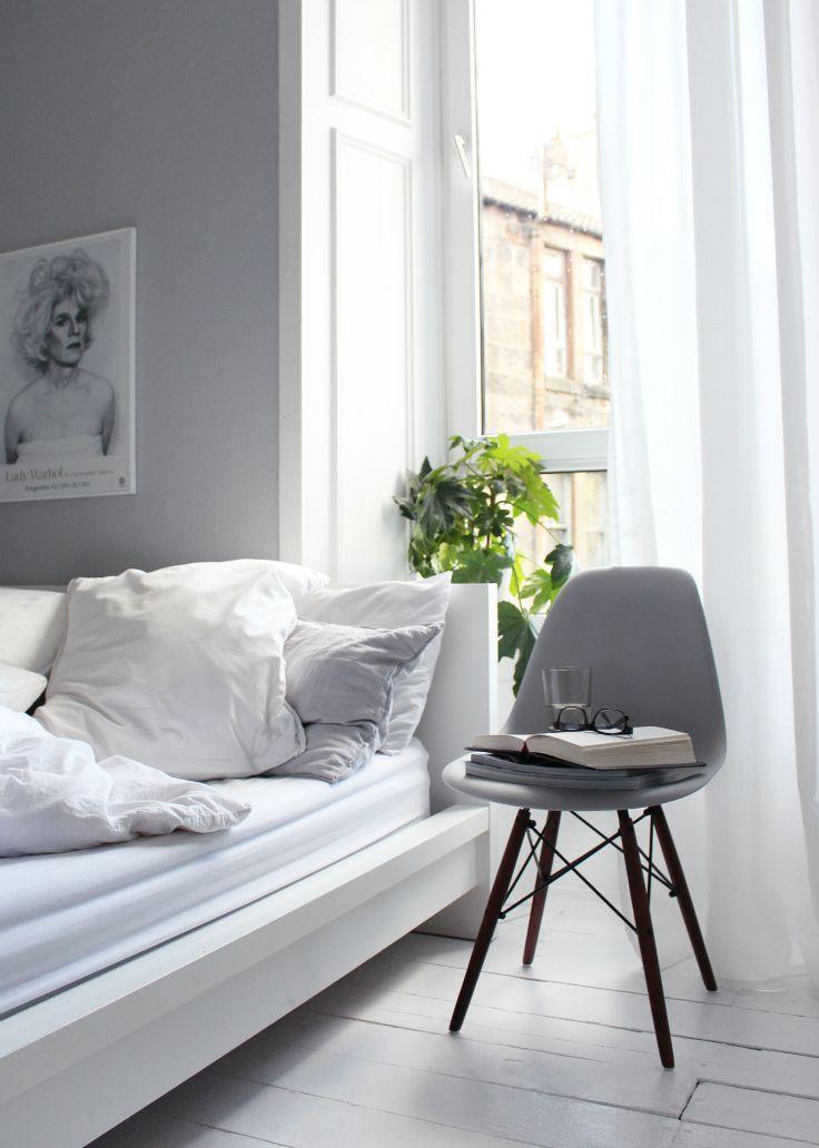 grey eames chair with dark legs walnut