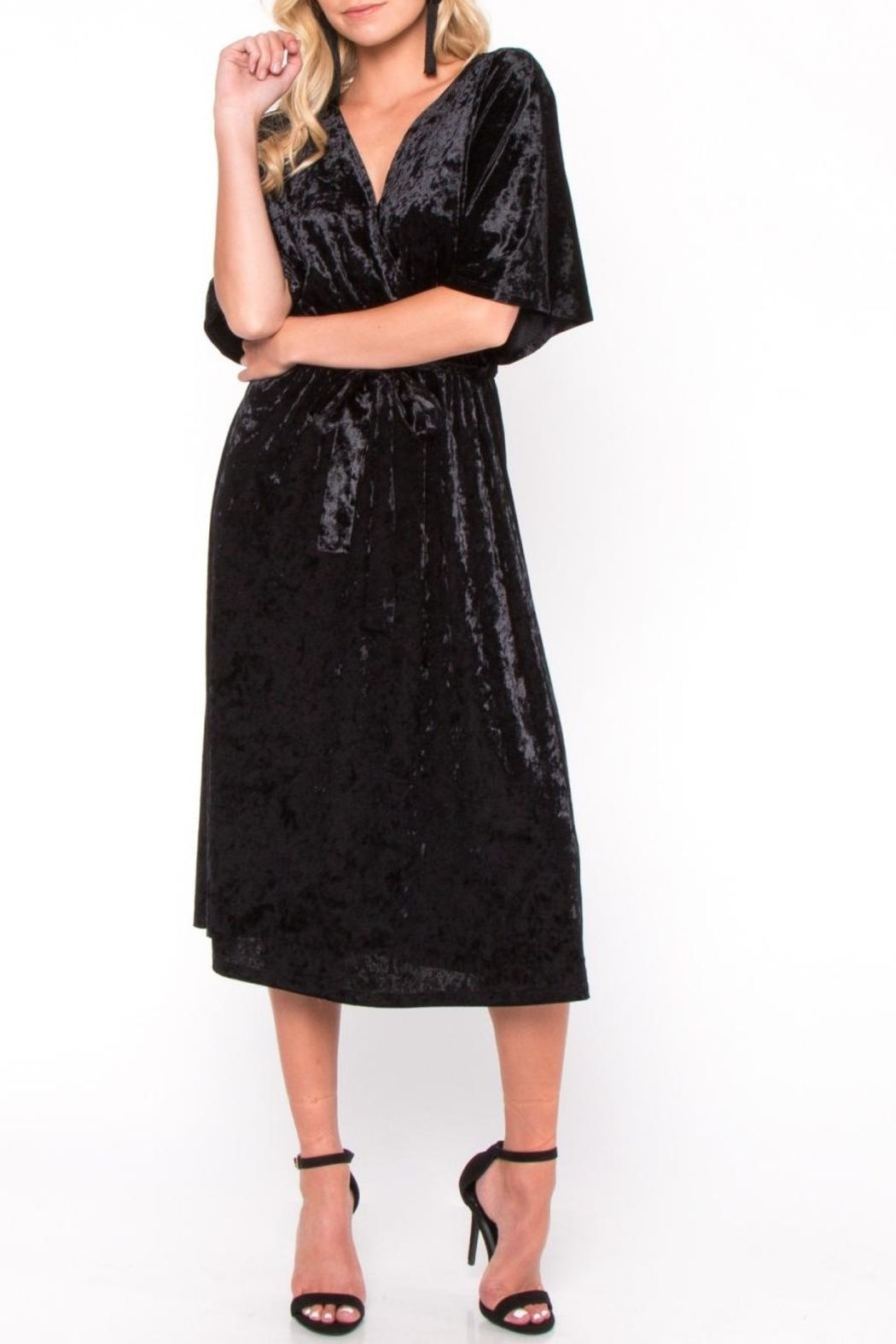 41071f8527639 Crushed black velvet midi dress featuring short bell-sleeves, draped in a  velvet wrapped silhouette. Soft comfortable fabric with slight stretch.