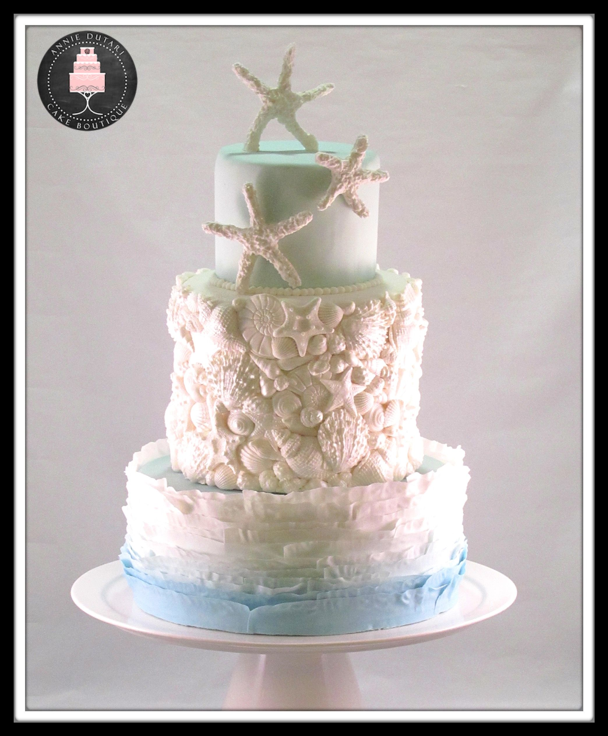 Beach themed wedding cake. Champagne and strawberries cake covered ...