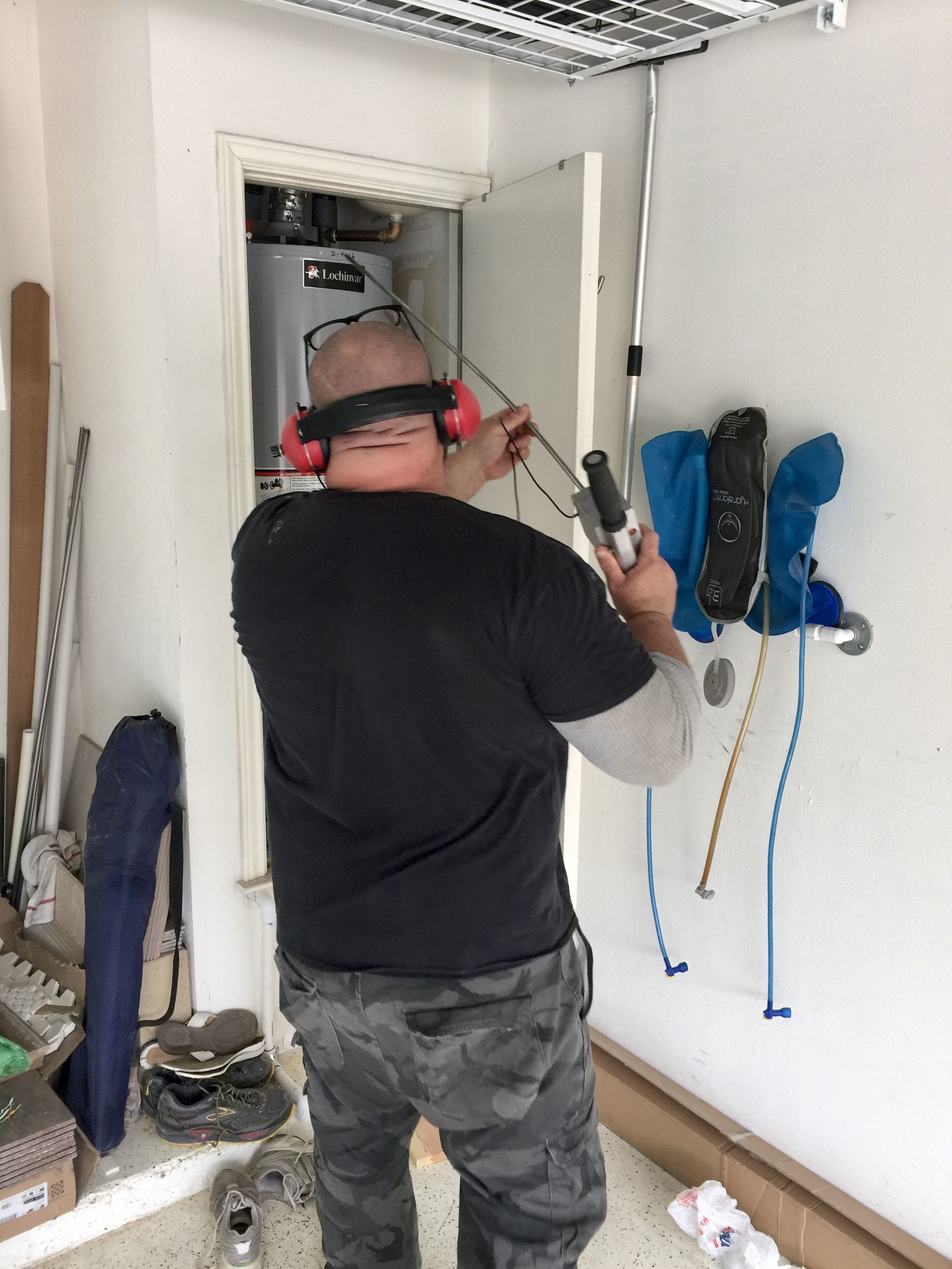 Checking for a leak in the waterheater line using our