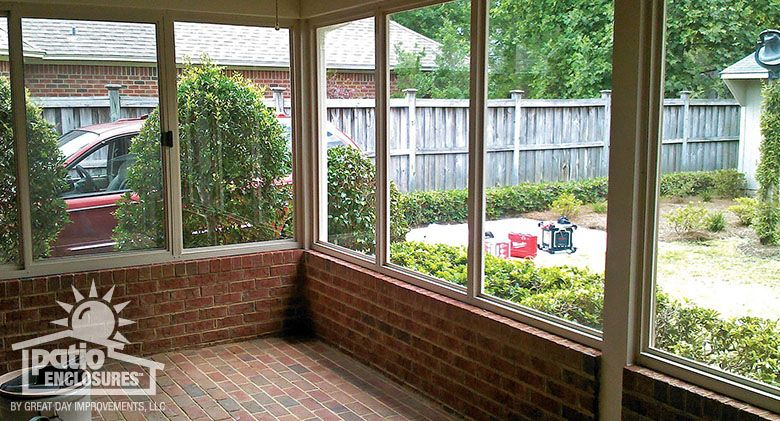 Screened In Porch Enclosure With Existing Brick Knee Wall And Foundation Front