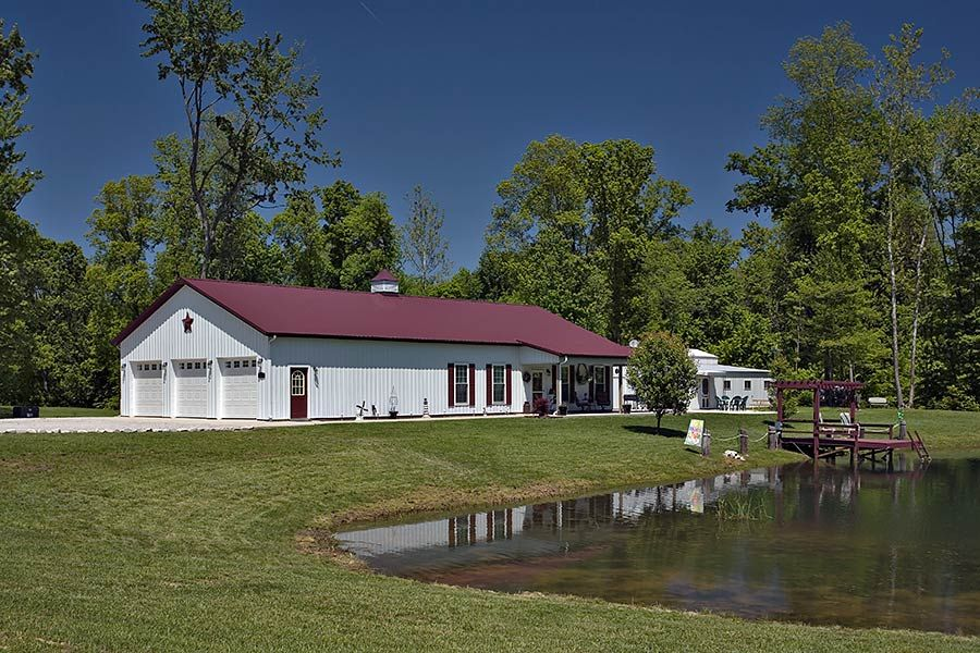 Metal barn with living quarters floor plans pole barn for Live in barn plans