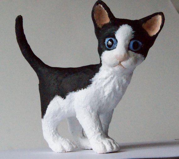 Susie, a handmade paper clay papier mache sculpture of a black and white kitten
