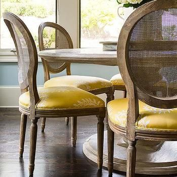 Round Marble Top Dining Table With Round Cane Back Chairs And Yellow Seat  Cushions, Transitional