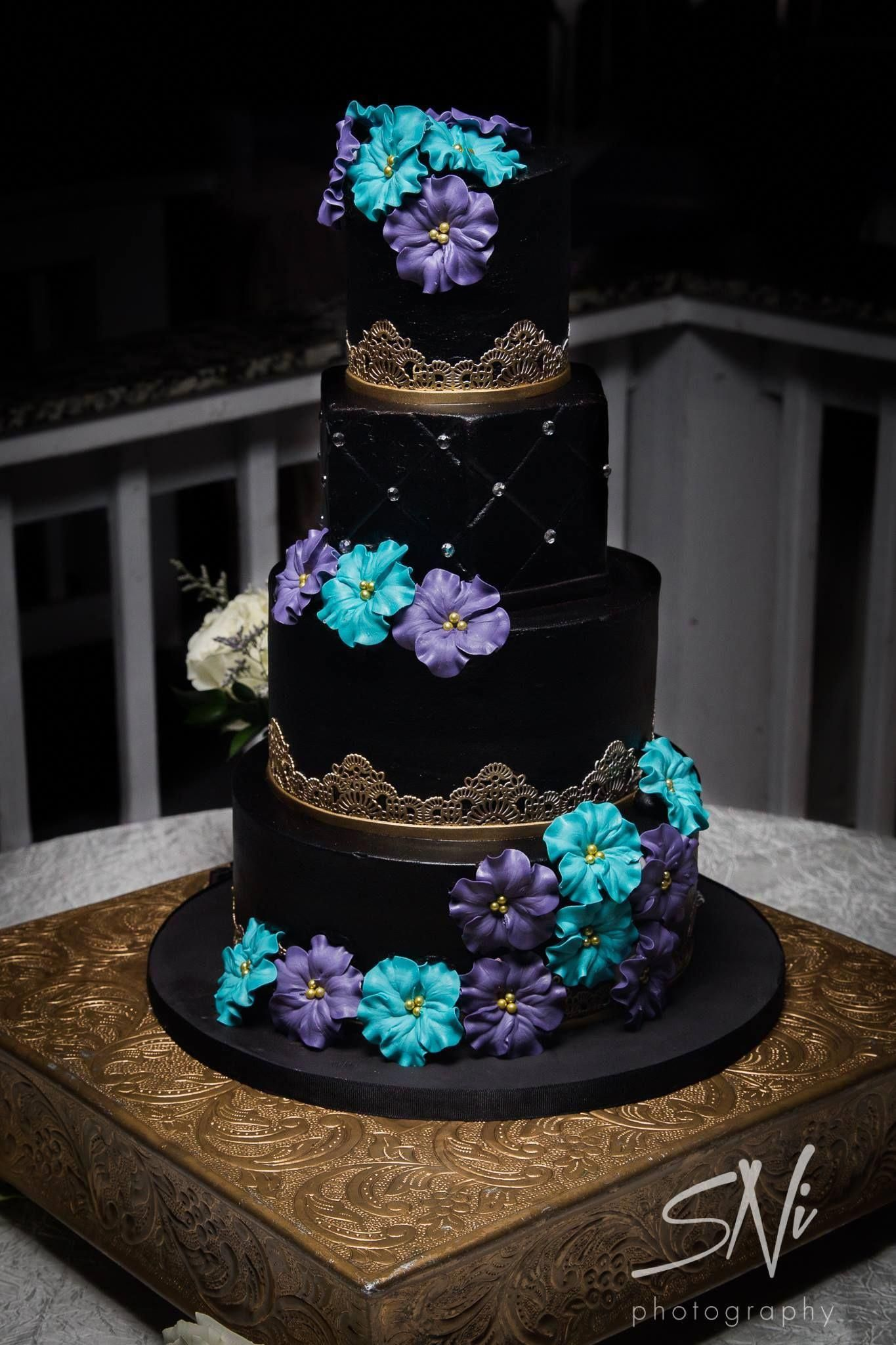 Black And Gold Buttercream Wedding Cake With Blue And Purple Sugar