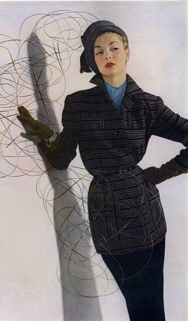 Jean Patchett in a stylish suit of Forstmann wool with a touch of silver Lurex running through by Monte Sano, hat by Lilly Dache, 1949