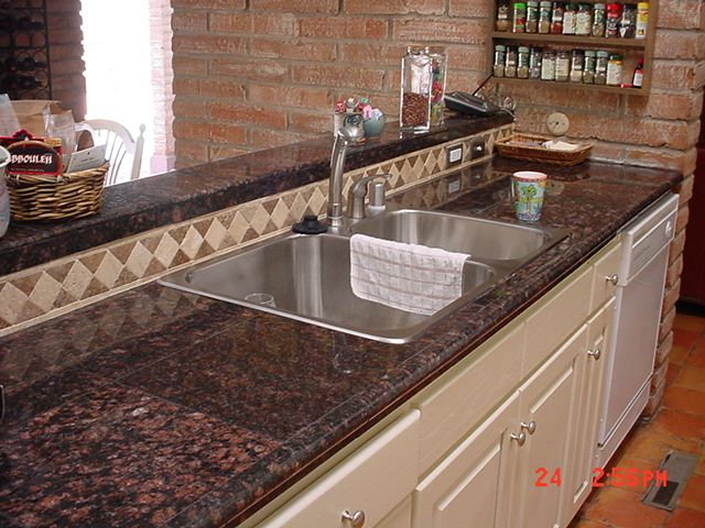 Granite Tile Kitchen Countertops granite tile counter top with dark grouting | kitchen counters
