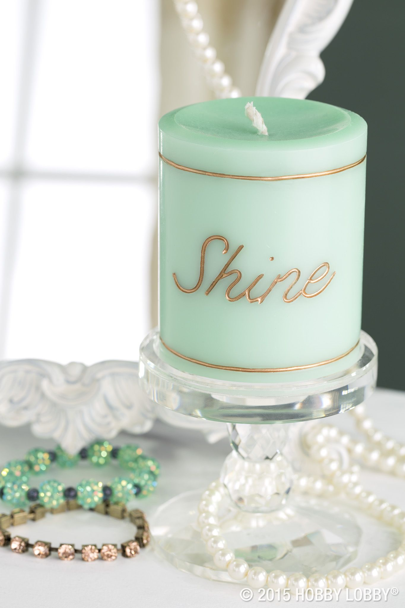 Want boutique-worthy pomp on a made-at-home pillar? Use a carving tool (Hobbies Department) to etch a word or pattern into the cooled wax. Then use a fine-tipped brush to apply metallic acrylic paint to the design.