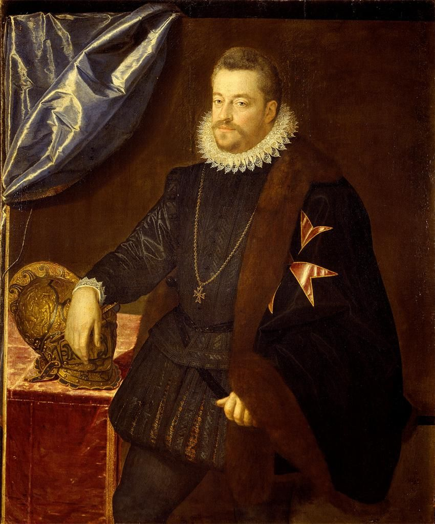 1590's Italian. Clearly showing shirt, doublet, jerkin over doublet, and a wonderful capelet.