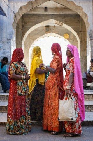 Women in colourful saris, Pushkar, Rajasthan, India, Asia.