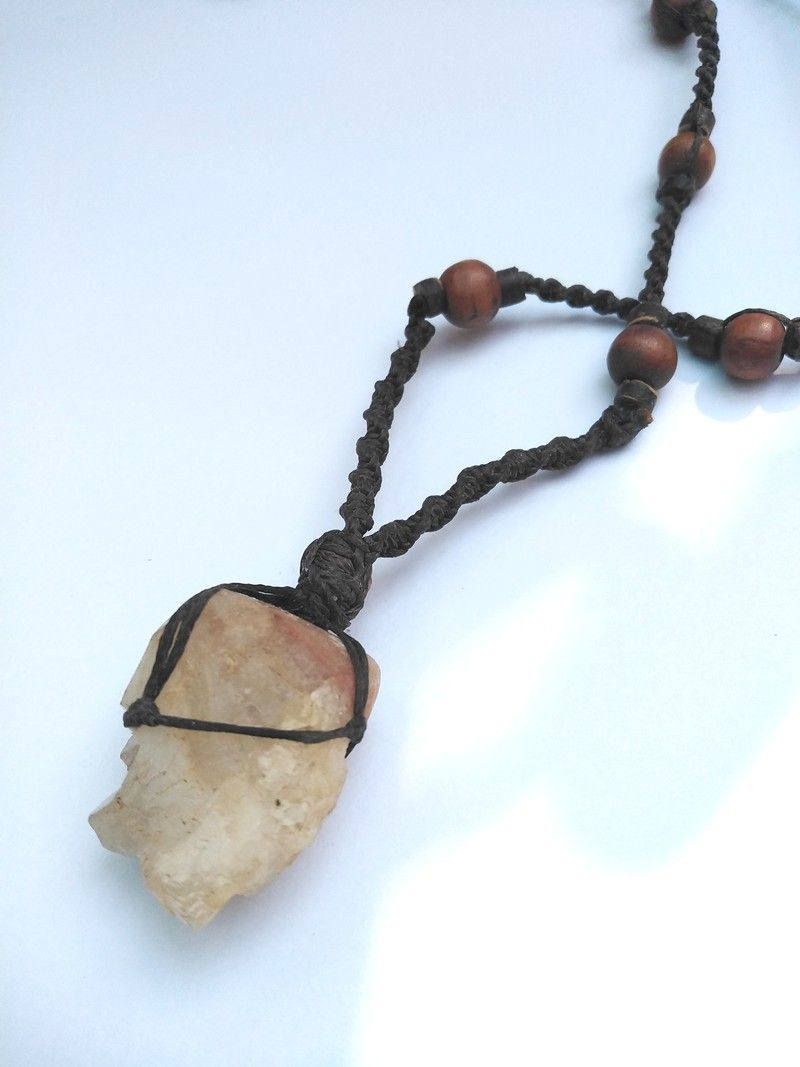 For him or her.   handmade macrame necklace with a natural quartz crystal stone, wrapped in net with different techniques of macrame,  vintage wooden beads on macrame cord.   this stone can enhance other energy, it is a generator for energy, and it will attune to your vibrational needs.   #macramejewelry #macramenecklace #crystaljewelry #cowrieshell  #cowrieshellnecklace #cowrieshelljewelry #meditationmacrame #healingcrystals #healingcrystalsandstones #healingcrystaljewelry #macramejewelry #macr