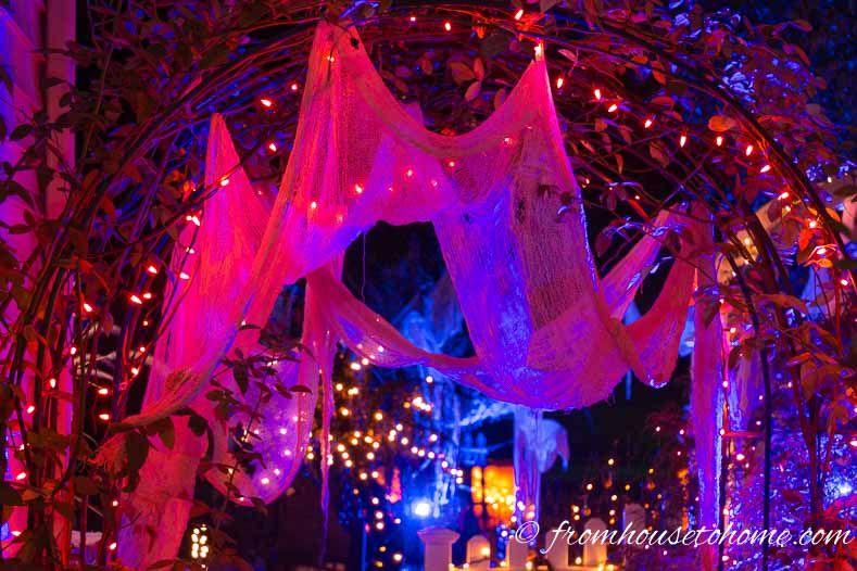 Halloween Outdoor Lighting Ideas 21 Spooky Ways To Light Your Yard Entertaining Diva From House To Home Halloween Lighting Outdoor Halloween Outdoor Decorations Outdoor Halloween