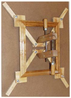Photo of Self-Squaring Picture Frame Jig  Torture device?  Maybe. Amazing way to save mys…