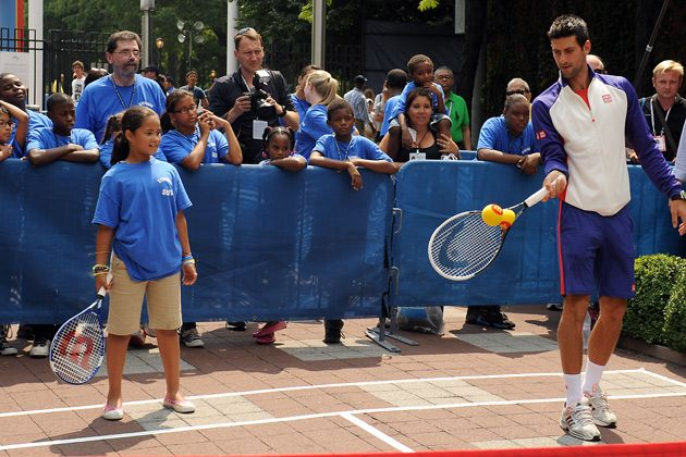 US Open defending champions, Djokovic, Stosur return the love with NYC kids at the US Open.