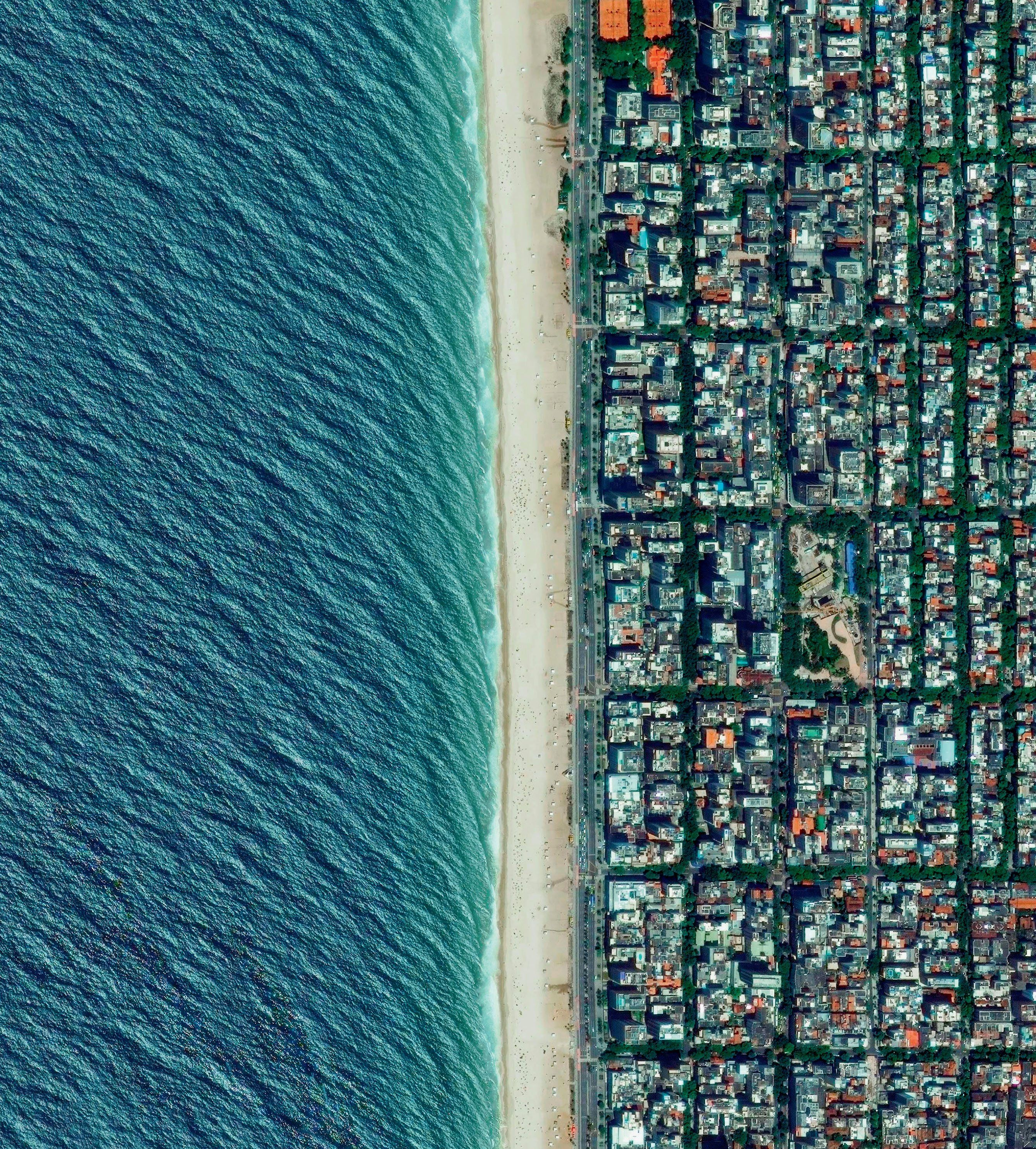 Ipanema beach is located in the South Zone of Rio de Janeiro, Brazil. Recognised as one of the most beautiful beaches in the world, the sand is divided into segments by lifeguard towers known as 'postos' Photograph: DigitalGlobe/Penguin Random House