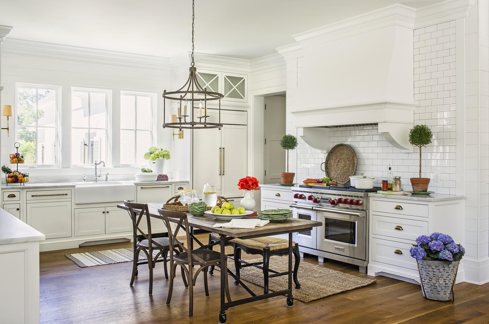 white kitchen with center table c brandon ingram ...