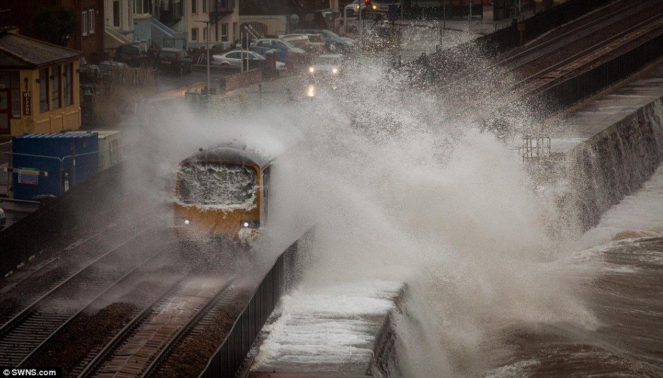 Giant waves crash into the a train at Dawlish in Devon, as 'Storm Doris' continues to batt...