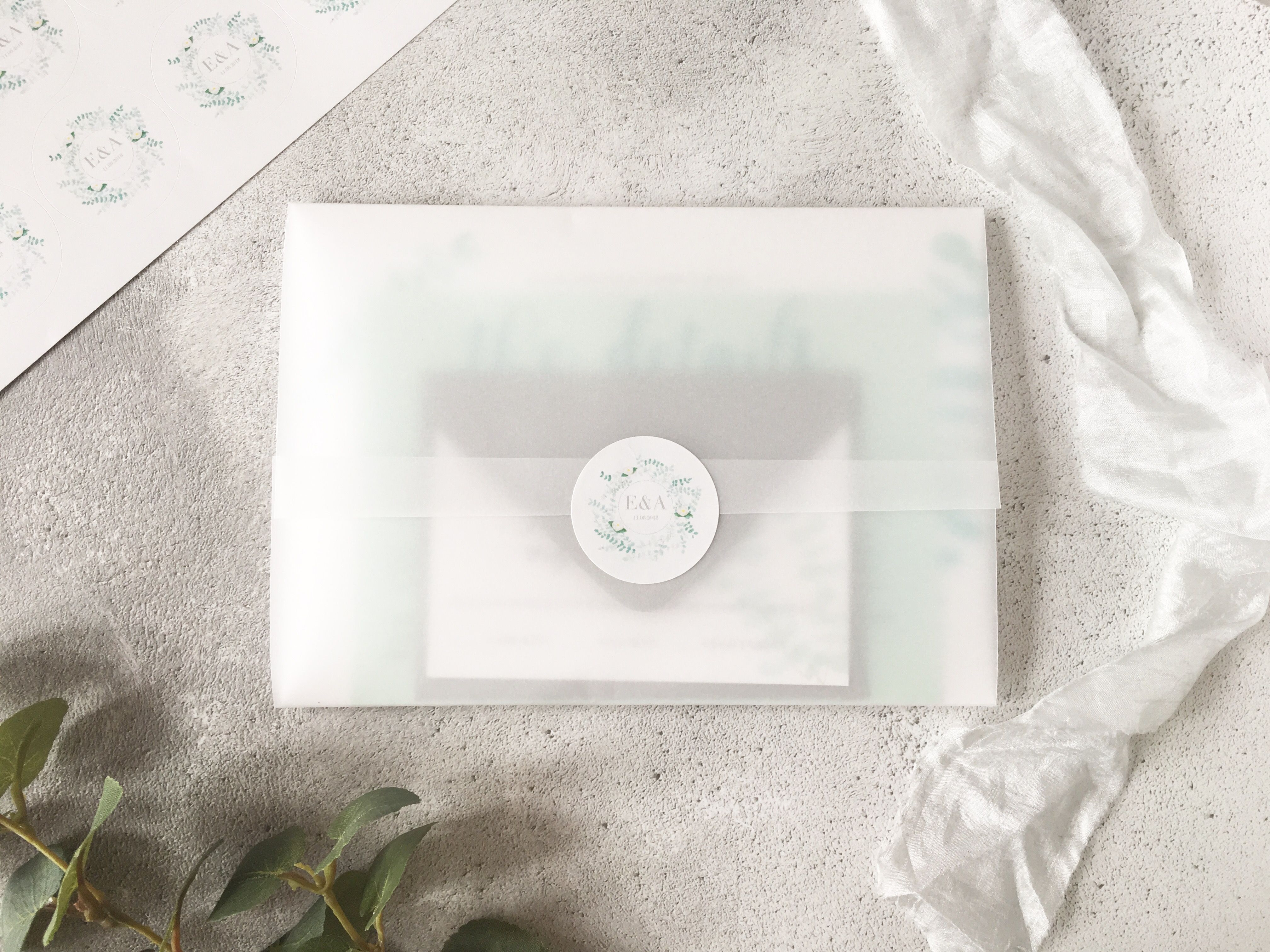 Eucalyptus wedding invitation design finished with a vellum wrap and ...