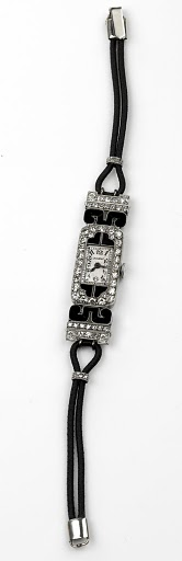 Lacloche Freres -French Art Deco lady's wristwatch set with diamonds and onyx, in platinum, circa 1925.