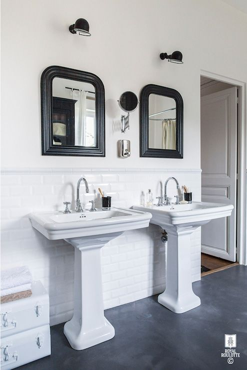 Black and white bathroom features off-white paint on upper walls and