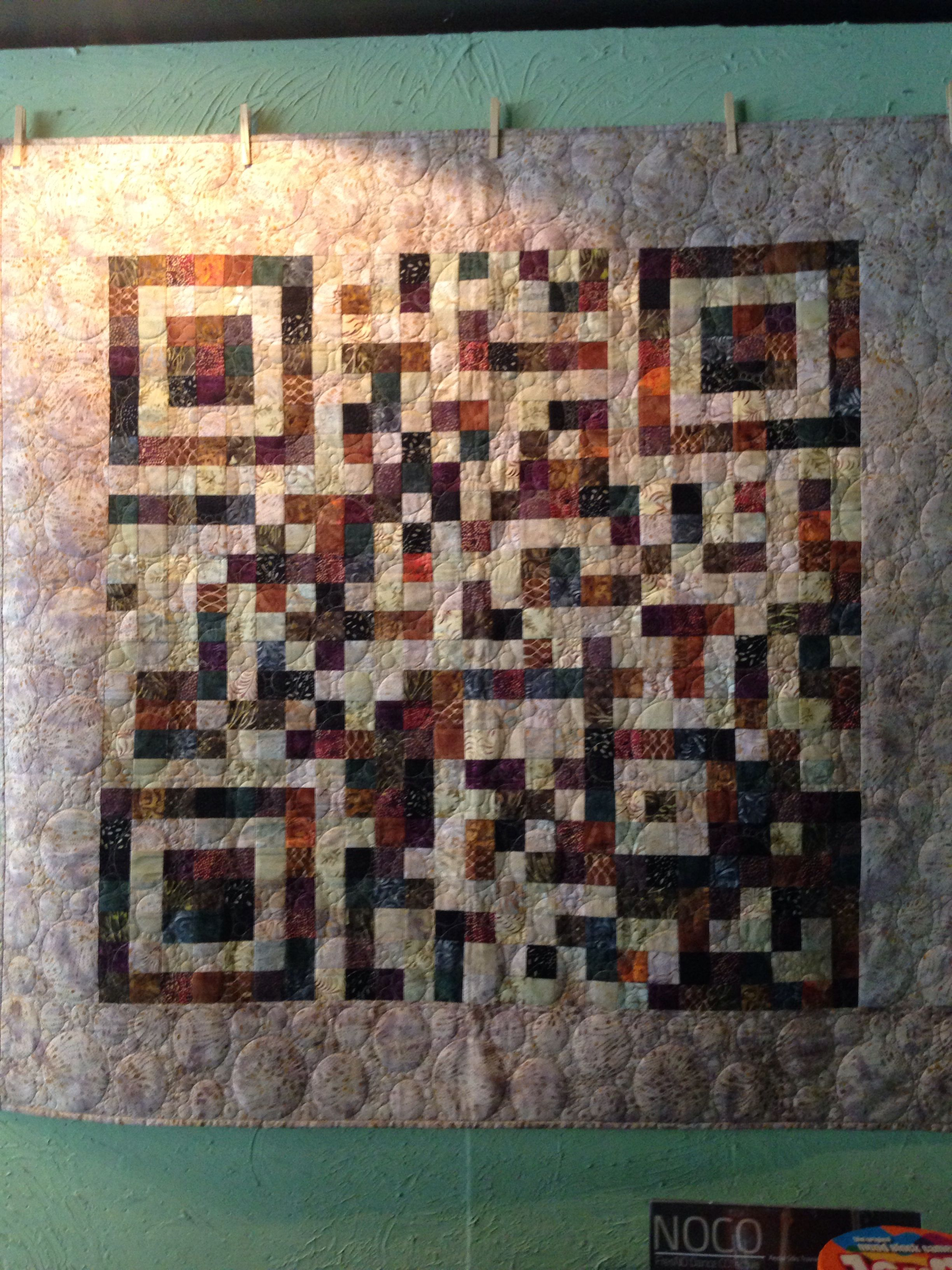 My sister gave Peeve's Public House a quilt that is a QR Code.