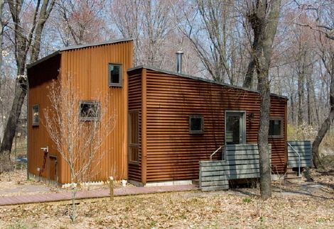 Metal siding fix cabins at tryon farm metal siding for Metal cabins homes