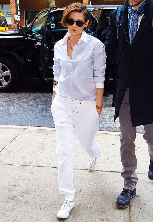 6b78da2451 Consider wearing a baby blue button shirt and white sweatpants to achieve a  chic look.