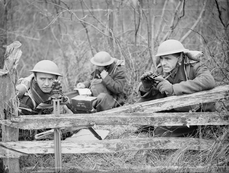 Battery observation officer (right) and signallers of a Czech artillery unit equipped with French 75mm field guns