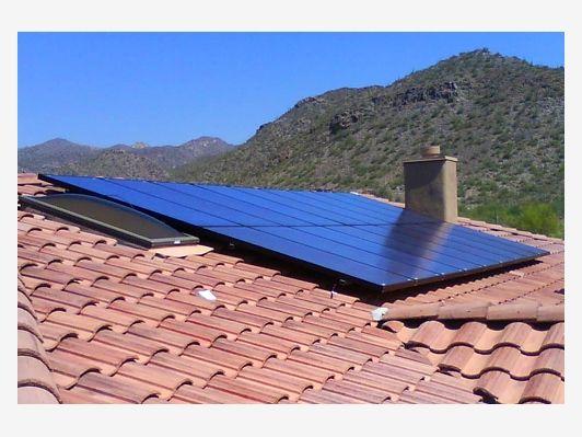 Solar Panels On A Tile Roof Solar Solar Panels Solar Powered Generator