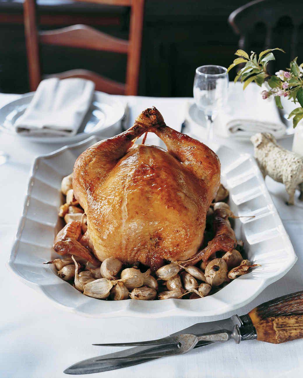 60-Clove Garlic Chicken | Martha Stewart Living - The garlic mellows as it cooks, deliciously accenting succulent roast chicken.