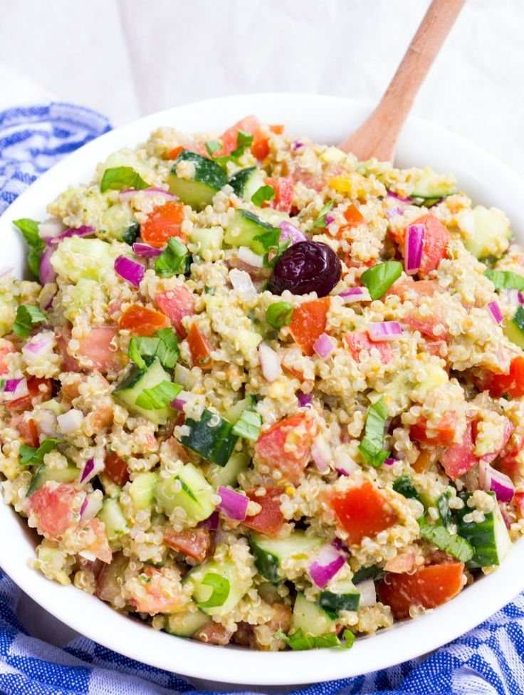 Pesto Quinoa Avocado Cucumber Tomato Salad - Full of protein-packed quinoa, crunchy and crisp veggies + creamy avocado, this salad has honestly become my new favorite salad for every potluck, BBQ and family get-together this Summer! #vegan #glutenfree #bbq #potluck #salad #summer