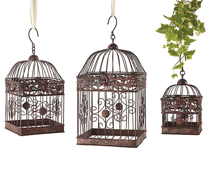 "#burtonandburton Dark brown iron nested set of decor birdcages, each with a hook at the top for hanging.  The tops lift up and is closed with a latch. 12"" H x 5"" W x 5"" D. 16"" H x 7"" W x 7"" D. 19"" H x 9"" W x 9"" D. 1 nested set of 3."