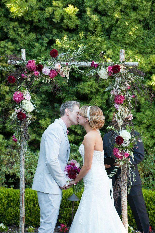 Birchwood wedding arch with flowers from local farmers marketarch - bodas sencillas