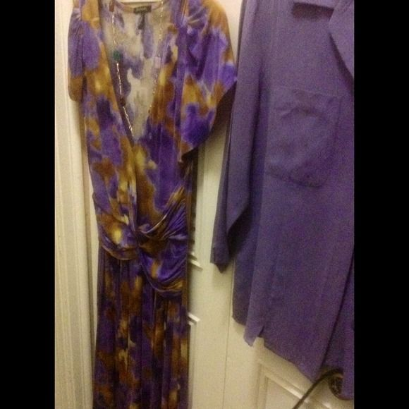 Watercolor Dress This slinky dress looks like a watercolor of purples, olds & yellows. It's gorgeous with a lavender jacket and some amethyst jewelry. Worn once for a short time. Daisy Fuentes Dresses