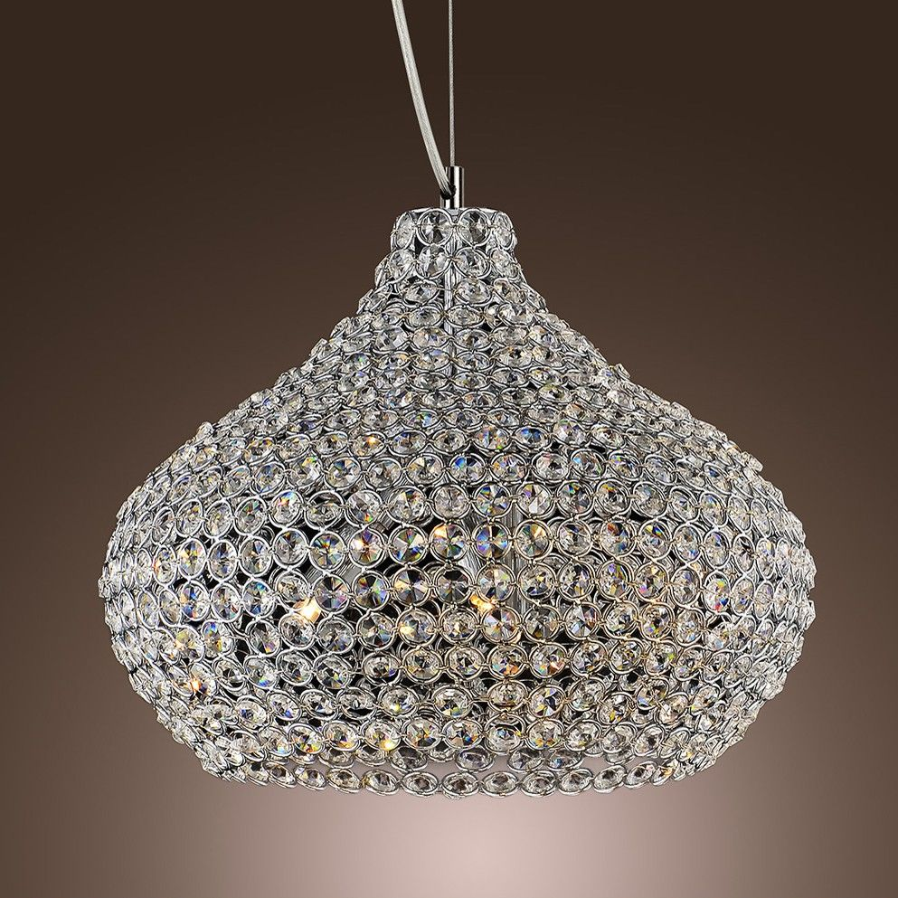 Gleaming and glistening, this suspension ceiling light is full of enchanting diamonds that sparkle when illuminated. Finished in a chic chrome, this design adds sophistication to any room. This pendant light features metal frame with shining crystal circles to form a curved shade for glamorous style.