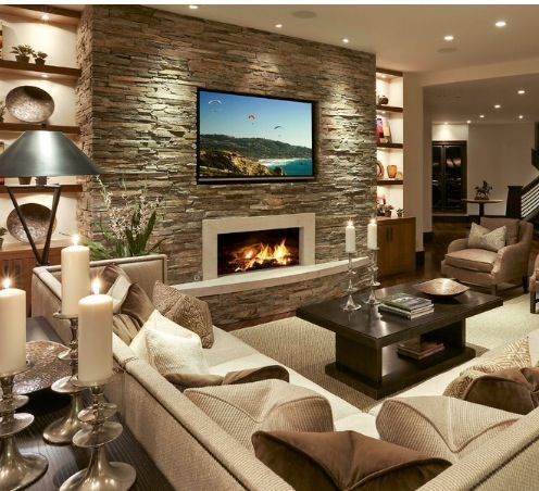 cozy ideas interior stone walls. Love the idea for a cozy basement  stone wall fireplace and lit up shelves 20 Living Room with Fireplace That will Warm You All Winter