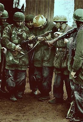 Fallschirmjäger examine a captured Thompson sub-machine gun