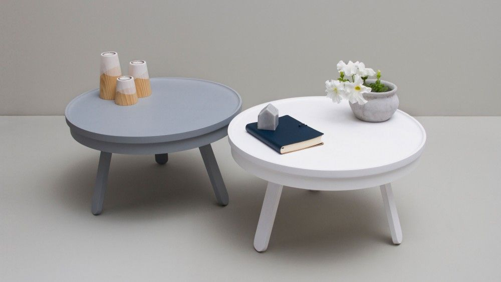 Batea table collection features complimentary storage space