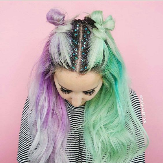 Purple Lavender Lilac And Green Split Hair Color Inspo For Blonde And Black Hair Finished With Small Buns And Glitt Hair Styles Hair Color Pastel Glitter Hair