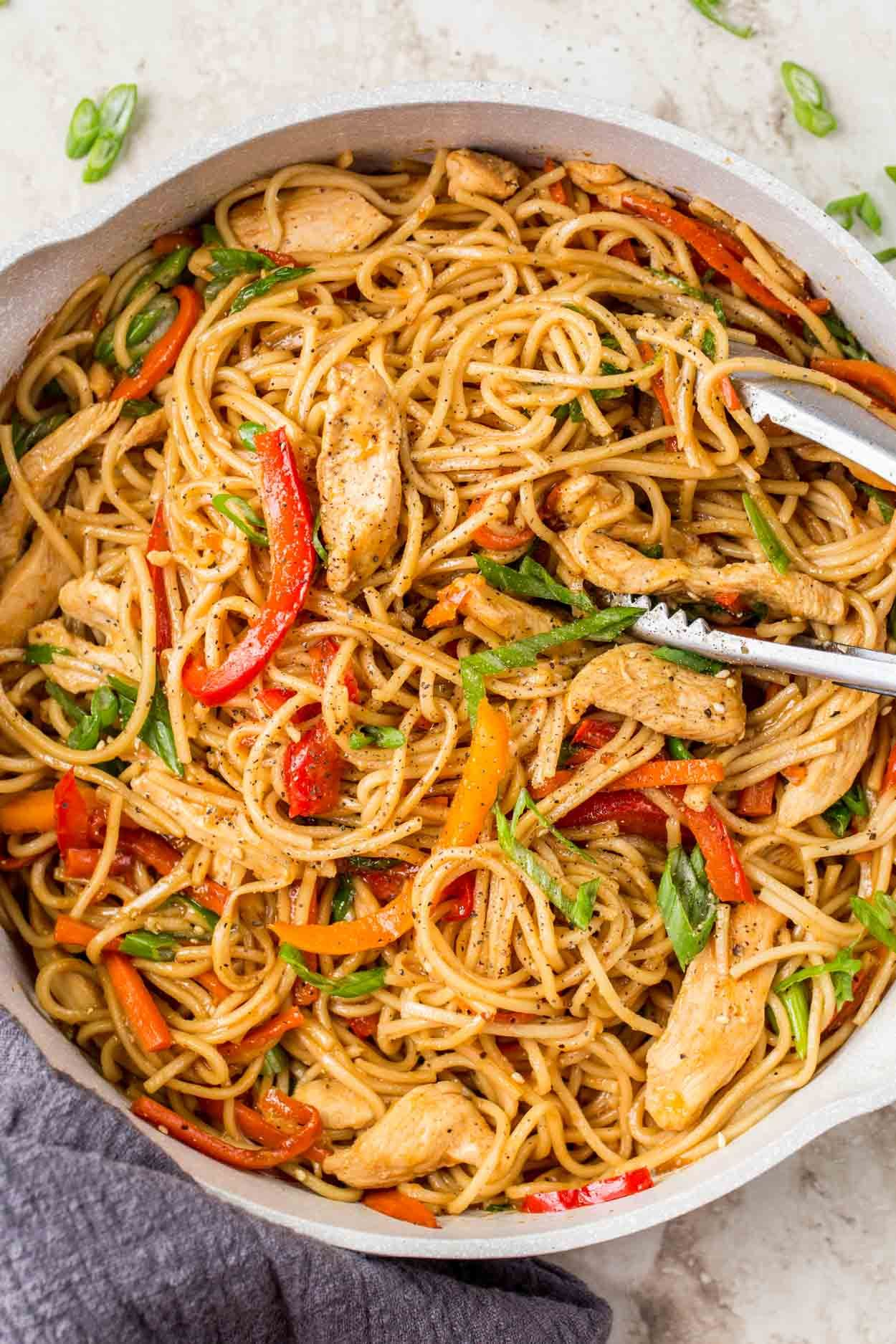 Quick and EASY homemade Chicken Lo Mein Recipe! Soft egg noodles loaded with chicken and vegetables in flavor-packed sauce, ready in just 30 minutes!