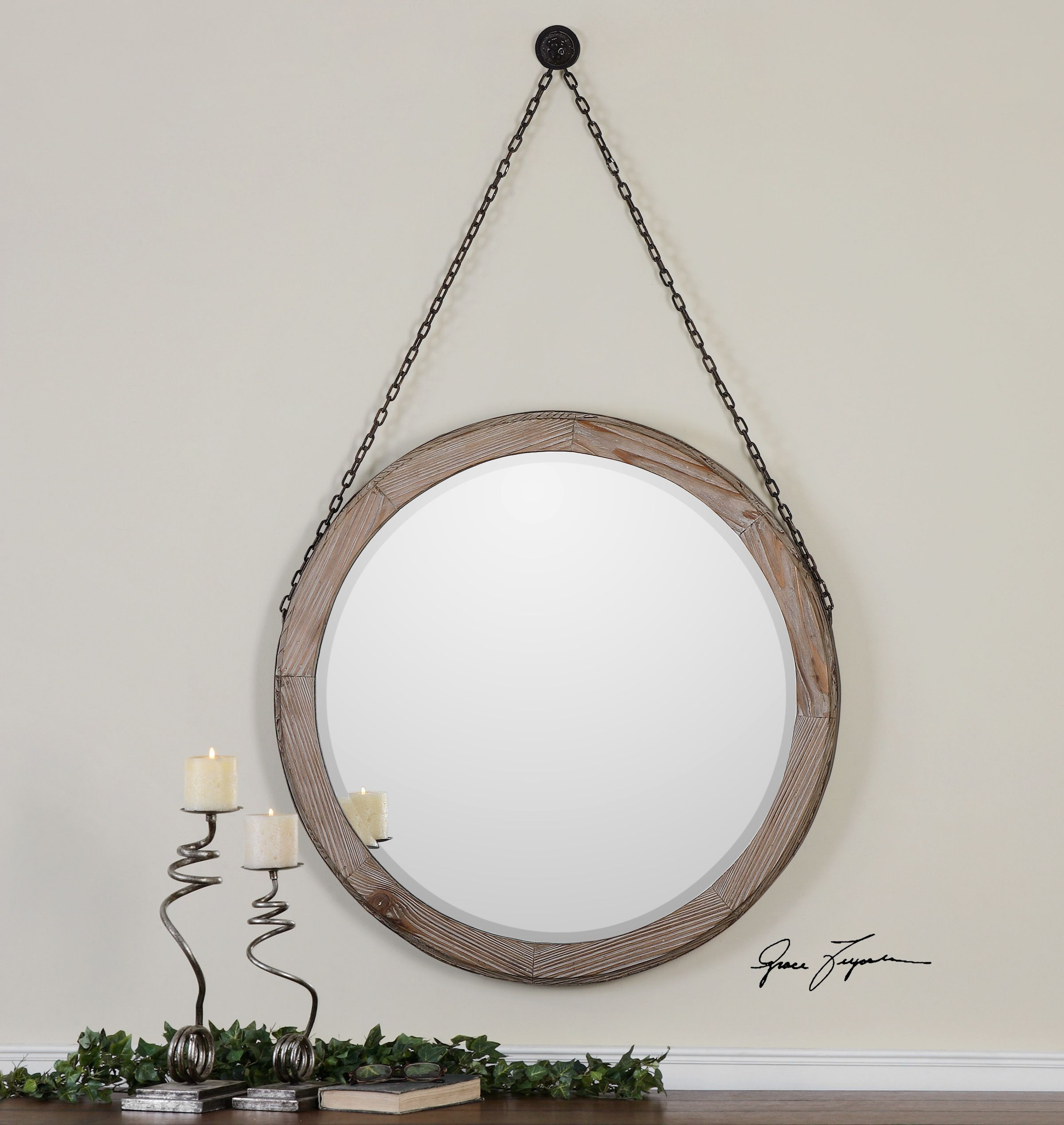 The slightly weathered, light wood stain on the Sandoval Mirror adds modernized rustic appeal to any wall.