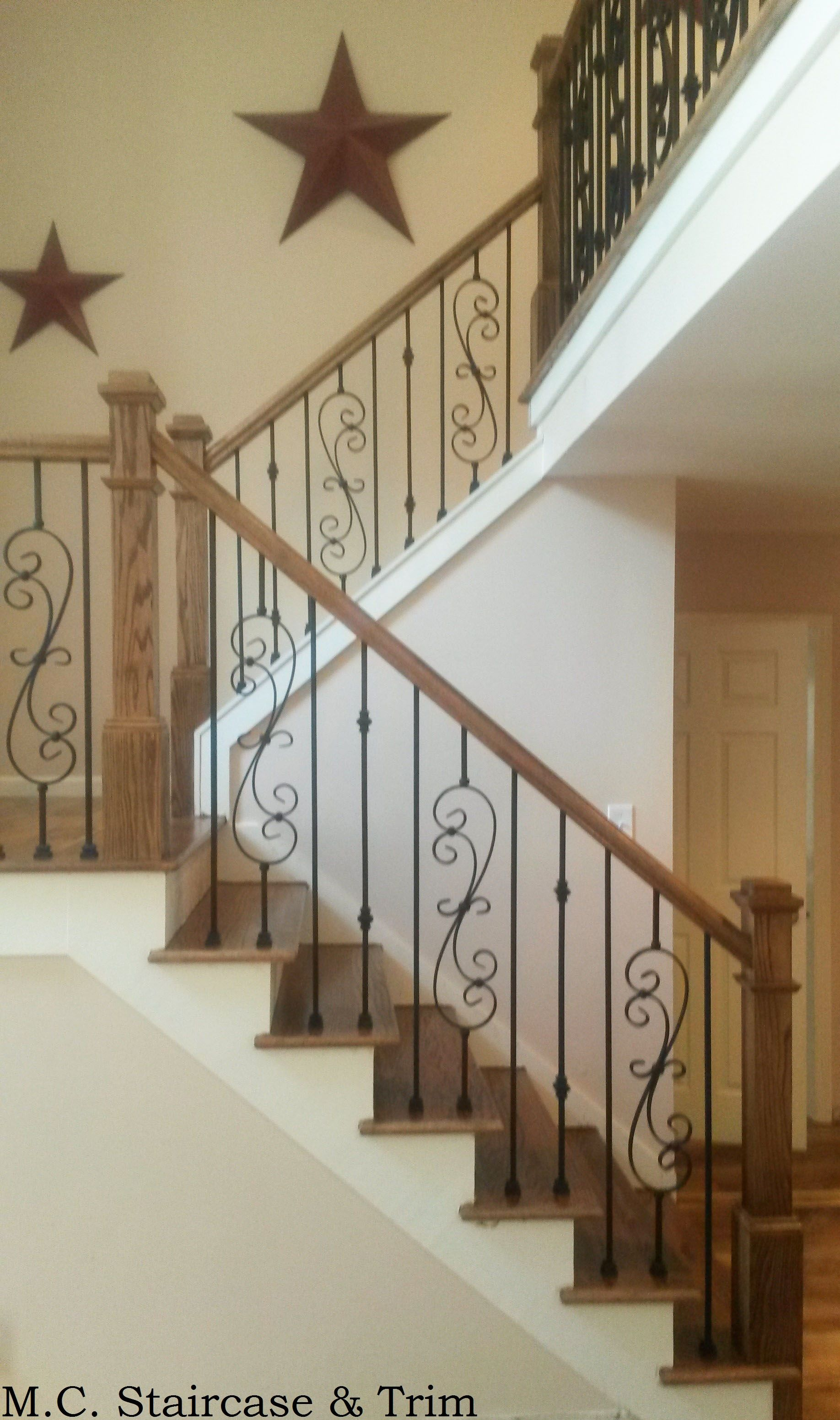 Iron baluster upgrade from M.C. Staircase & Trim. Removal of wooden  balusters and installation of