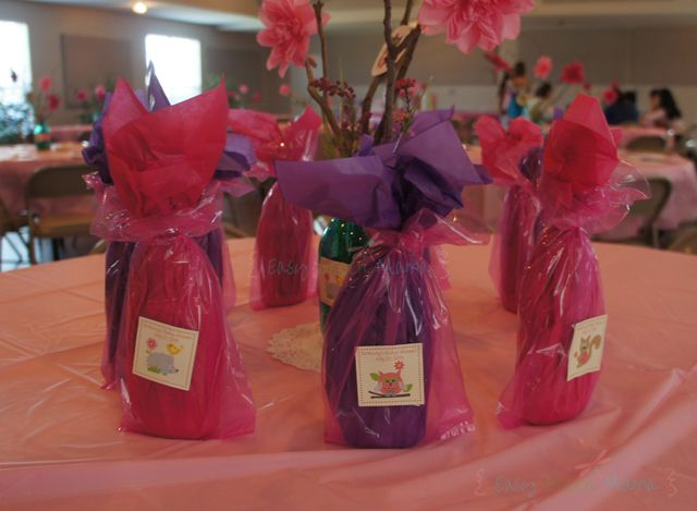 prize ideas for baby shower games lotion wrapped in tissue favor bag and add