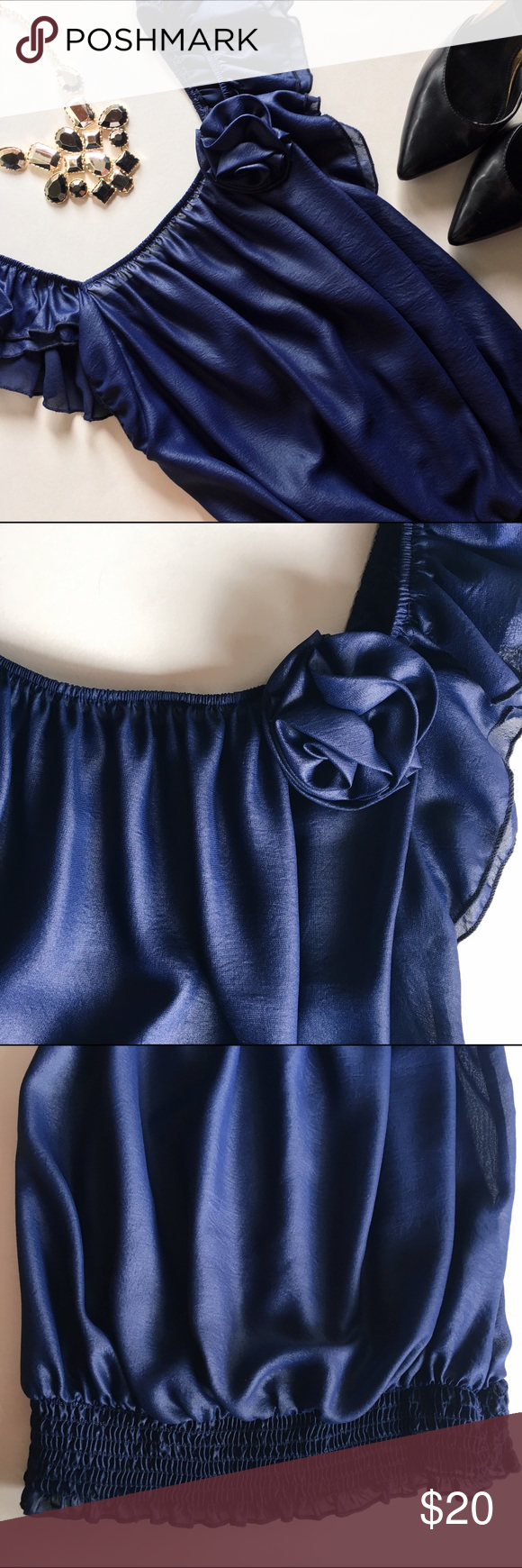 A'Gaci Navy blue off-the-shoulder blouse Super light and comfortable navy blue top with a rose detail. Can be worn off-the-shoulder. Tight at the bottom. Perfect to dress up with a skirt or wear with jeans. Lightly worn. 100% polyester a'gaci Tops Blouses