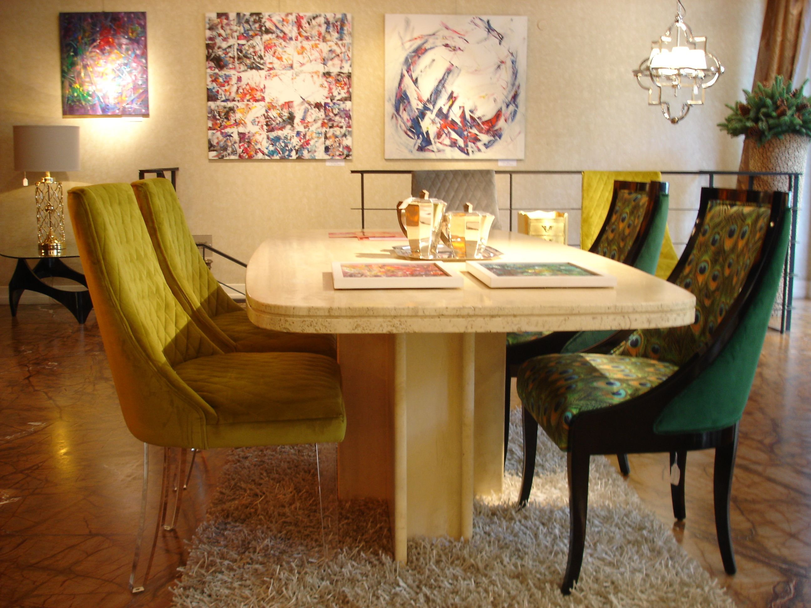 Vintage travertine dining table with art deco and modern chairs